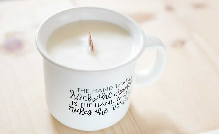 candle mug the hand that rocks the cradle is the hand that rules the world white mug wooden wick candle
